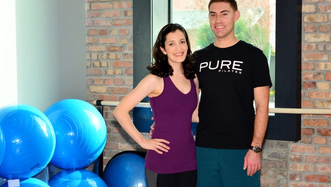 Maribel and Adam Wilkie working out together at Pure Pilates.