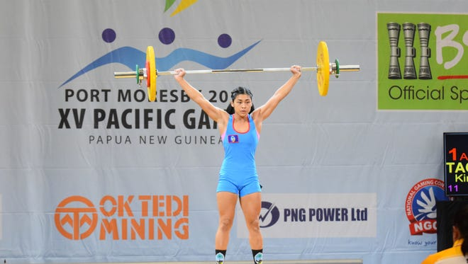 Guam weightlifter Kimberly Taguacta lifts a 57-kilogram snatch in her first attempt. She completed a 62-kilogram snatch at the Sir John Guise Indoor Gymnasium to secure Guam's first individual medal at the 2015 Pacific Games at the Port Moresby, Papua New Guinea. Taguacta competed in the 53-kilogram senior divison