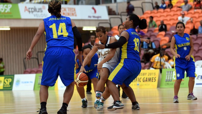 In this file photo, Guam competes against Nauru in women's basketball at the Taurama Aquatics Center and Indoor Sports Complex at the 2015 Pacific Games in Port Moresby, Papua New Guinea. Team Nauru has pulled out of the 2018 Micronesian Games due to travel costs.