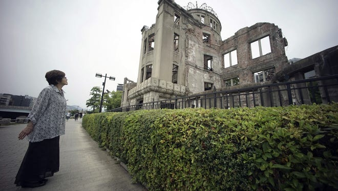 In this July 3 photo, Kimie Mihara, a survivor of the 1945 atomic bombing, looks at the Atomic Bomb Dome, as it is known today in Hiroshima, Hiroshima Prefecture, southern Japan. Built in 1915, the dome building was a rare example of Western architecture in Hiroshima at the time. Czech architect Jan Letzel designed it to be a city landmark and an exhibition hall for industrial and cultural promotion. Mihara was a worker at a government office in the dome building in 1945.