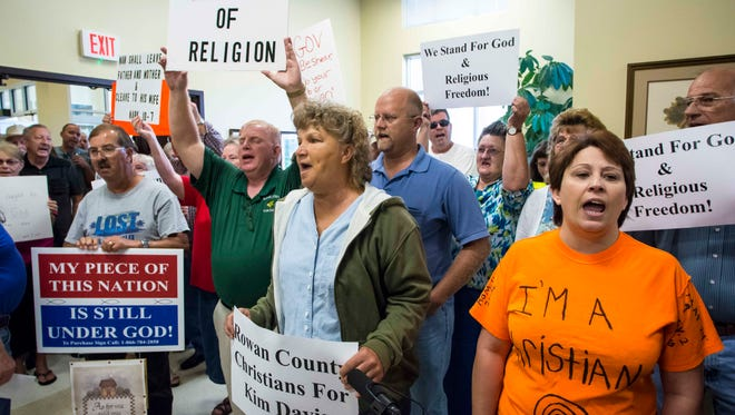 Supporters of Kim Davis chant in support of the Rowan County clerk after Davis denied marriage licenses to two same sex couples Tuesday morning. (September 1, 2015)