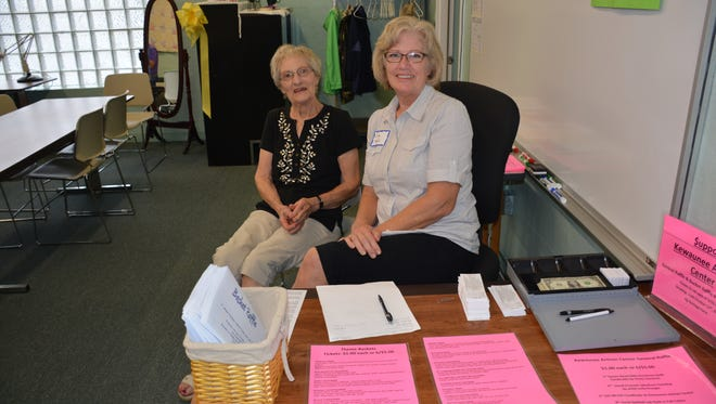 Cindy Machut (right) and her mother Ann Clark sell raffle tickets for the artisan's Art and Quilt show on October 17 at the Agricultural Heritage Center.