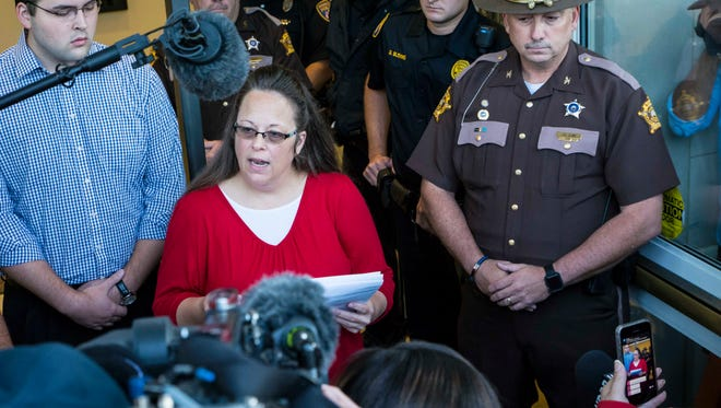 Rowan County Clerk Kim Davis speaks to the media at the front of the courthouse Monday morning, saying she will not interfere with her deputy clerks, but she will not personally issue or authorize marriage licenses.