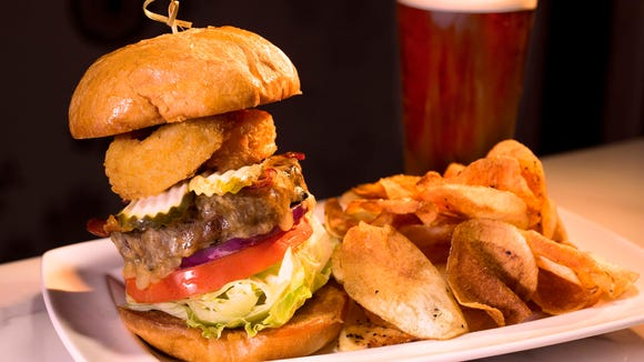 The tavern burger is one of many entree options at the Spotted Horse Tavern & Dining Parlor, which recently opened in Evangeline Downs Racetrack and Casino.
