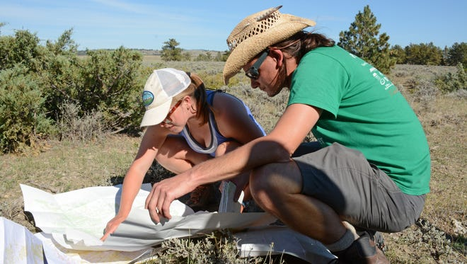 Wilderness Institute leaders Christy Curd and Jesse Bergeson peruse the Cow Creek Wilderness Study Area map on Sept. 23 to decide where the next round of monitoring should be done.