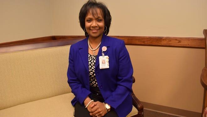 Yolanda Holts, director of the Cabrini Cancer Center, is a cancer survivor as well.