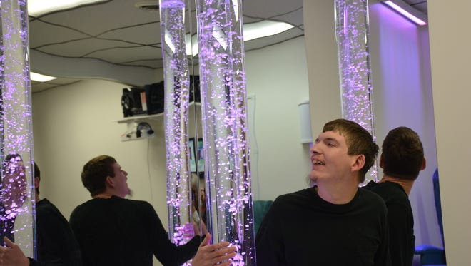 Matt Boulenger of East Shore Industries examines the bubble tube in the new Snoezelen Multi-Sensory Therapy Room.