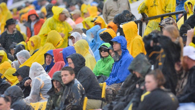Southern Miss fans endure the rain while watching the action  during the second quarter.   The Golden Eagles defeated UTEP to become bowl eligible.