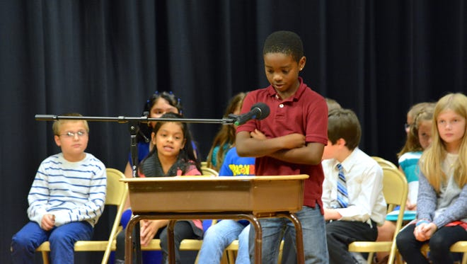 Southern Sussex Rotary spelling bee winner Rosnell Lewis Jr. listens to the word he needs to spell during the first round of the competition Tuesday, Nov. 10.