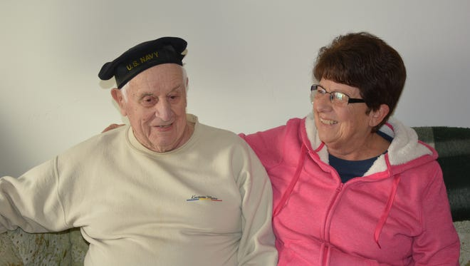 "Larry Verdegan, 94, a World War II veteran, shares a war story with his daughter Carol Rohr of Kewaunee.  ""The grandkids really like to hear the stories,"" said Carol."