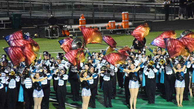 Students at Gulf Coast High School give a preview of their Macy's Thanksgiving Day performance during a halftime show.