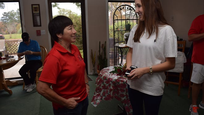 Mary Ann Reddoch (left), a board member of First Tee of Cenla, talks with Sarah Corley, a Pineville High School senior, who is one of the youth ambassadors for First Tee of Cenla. Saturday marked 10 years the youth development program has been active in the area.