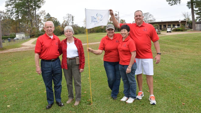 Buddy Stroud (left), Andrea Mattison, Paula Sue Dechert, Mary Ann Reddoch and Kevin Miles, board members of the First Tee of Cenla, marked 10 years Saturday that the youth development program has been active in the area.