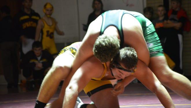 The Spartans heavyweight Phil Rasmussen battles Coleman's Donovan Salewski.