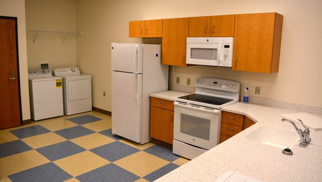 A new Sussex Consortium classroom at Beacon Middle School has features from an apartment to teach students life skills.