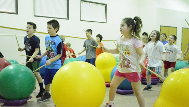 Chenango Bridge Elementary School third-graders get active during their first Drums Alive activity Tuesday.