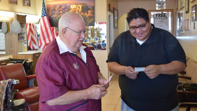 Papa Joe helps his long time customer, Wolf Brown, select a Powerball ticket.