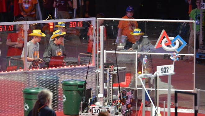 Members of the Spencerport Rangers FIRST Robotics team in competition with their 2015 robot Fillmore. From left: Anthony Fortunato, Danny Bevona and Eric Frisbee.