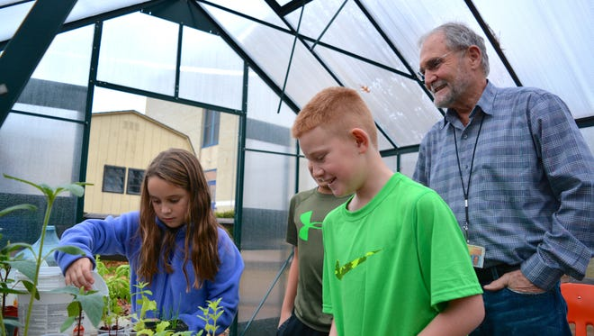Students maintain plants in the Rehoboth Elementary School's greenhouse, under the watchful eye of teacher George Meili, in December 2015. The Cape Henlopen School District is asking voters to approve new spending for rebuilding and renovating elementary schools in a March 23 referendum.