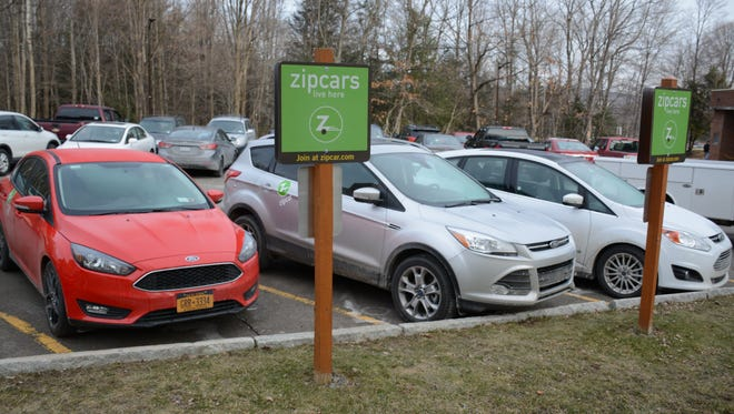 All three Zipcars in Lot D on Binghamton University's Vestal Parkway East location sit ready for a BU student, faculty or Binghamton Community member to rent with a Zipcar membership.