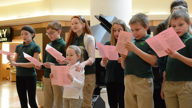 All Saints School students sang Sunday at the Oakdale Mall in Johnson City to kick off national Catholic Schools Week dedicated to raising awareness of the country's catholic schools.