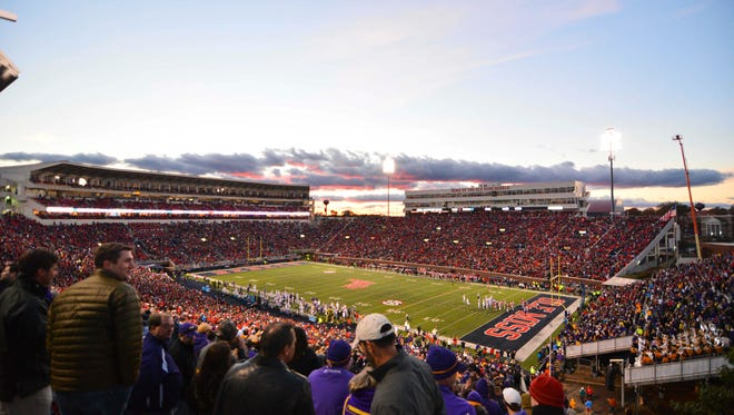 Nov 21, 2015; Oxford, MS, USA; The sun sets as fans watch the action between the Mississippi Rebels and LSU Tigers during the third quarter of the game at Vaught-Hemingway Stadium. Mississippi won 38-17.  Mandatory Credit: Matt Bush-USA TODAY Sports