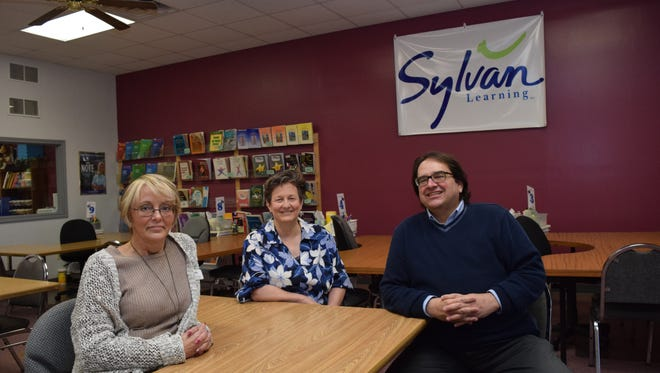 Terri Harmeyer (center) and husband Tom Harmeyer are the new owners of Sylvan Learning Center located on Texas Avenue near the corner of Jackson Street in Alexandria. Sharlene Stinson (left) is associate director of the center.