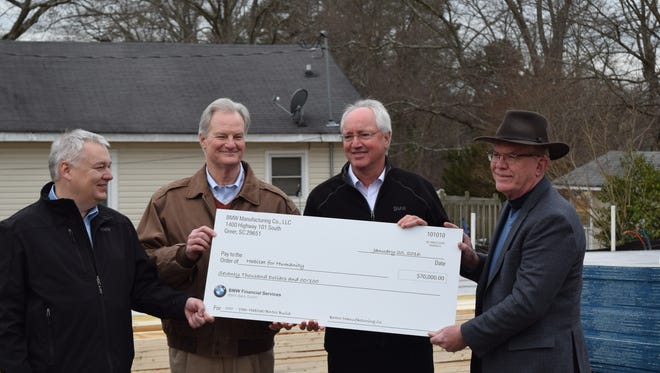 BMW has presented a check for $70,000 and will supply volunteers to build a new home for a family in Greer through a special partnership between the organization's affiliates in Greenville and Spartanburg counties.