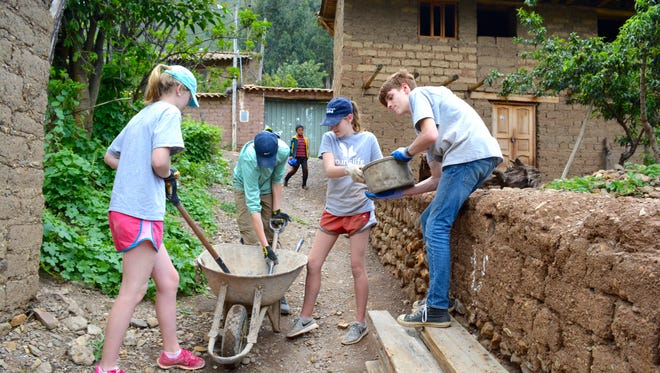 Carolina Day students worked on a building during a service learning trip through Peru.