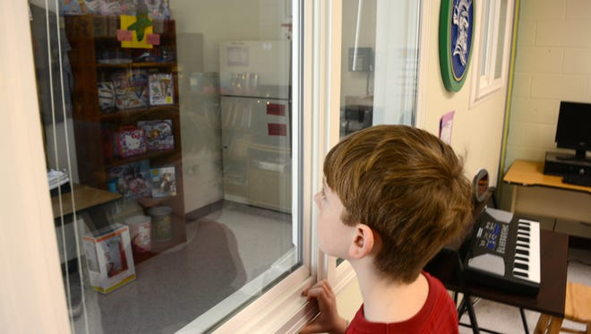 Third-grader Peyton Strait gazes at the Carver Cove's school store at the G.W. Carver Center.