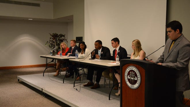 Candidates from the Vitality and Advance parties (pictured left and right, respectively) talked platform points and real change during Monday's executive debate.