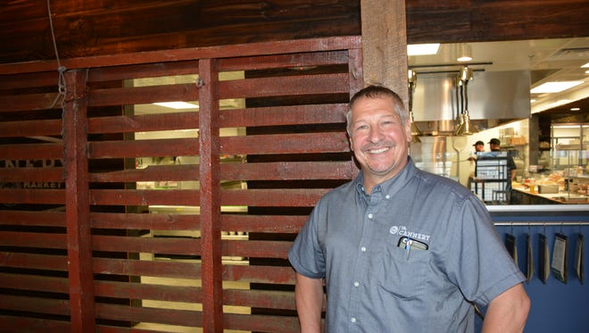 John Pagel, Kewaunee County Land and Water Conservation chairman, at The Cannery Public Market, his Green Bay restaurant.
