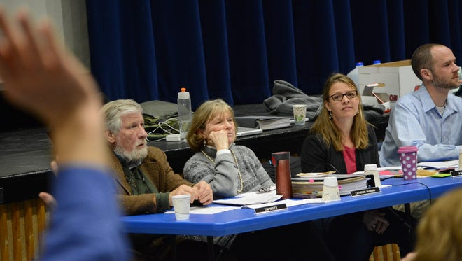 Jericho's selectboard and town administrator listen to residents discuss funding for the Jericho Historical Society.