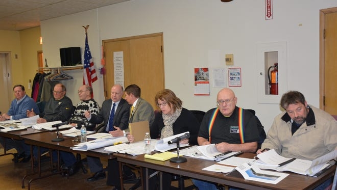 The City of Kewaunee Plan Commission reviews plans for the agricultural education building proposed by the Kewaunee School District at a public hearing Feb. 25.