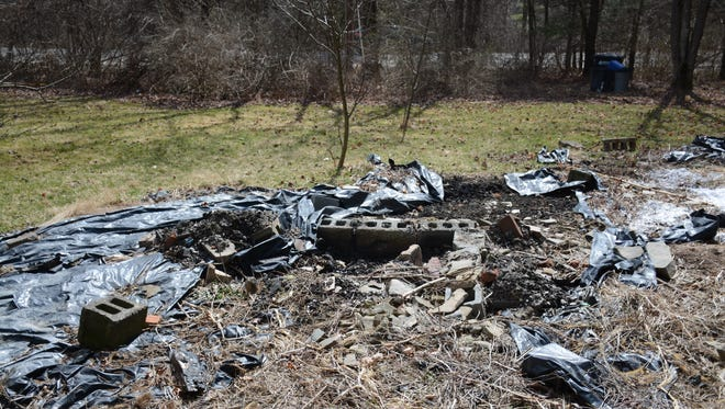 The burn pit in Lockwood where attorneys for Cal Harris say a partial bra strap and pieces of fabric were found earlier this year that could have belonged to Michele Harris and could help prove their client is innocent.
