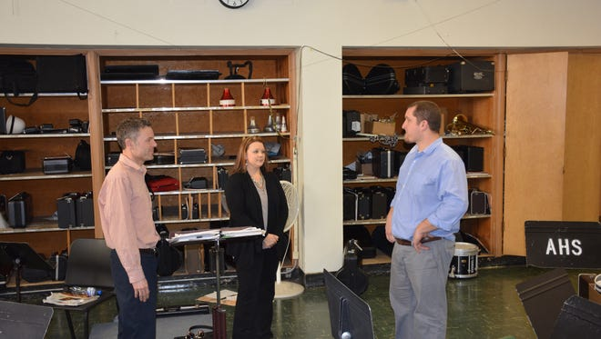 Funds from the referendum would be used to upgrade the current band room, which is overcrowded and outdated.   Left to right, Dave Robertson, vocal music director,, Jennifer Massey, band director, and Superintendent. Nick Cochart.