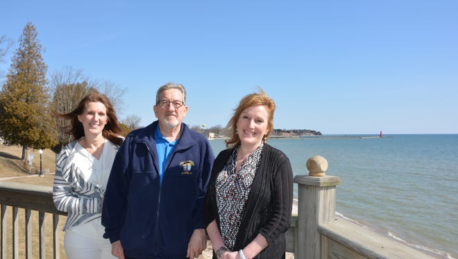 Robyn Harper, left, Mayor Wayne Schmidt and Joy Krieger stand at  the location on the deck of the Algoma Visitor's Center where they hope a new telescope will be installed soon.