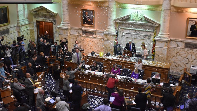 Confetti rains down on the House of Delegates at midnight on  Monday, April 11, the last day of the 2016 Maryland General Assembly.