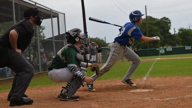 Oak Hill's Chase Gardner (13, right) bats against Grace Christian.