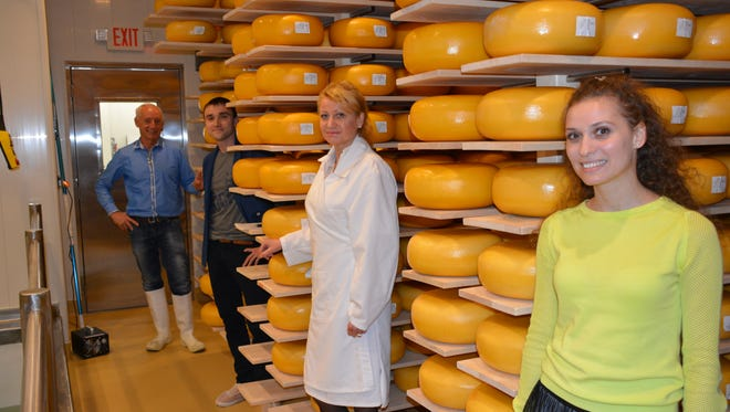 The Wakker family has been working since last fall to produce and age their Gouda cheese behind their Kewaunee store.   Left to right, Johannes Wakker, son-in-law Sergiy Aleksieiev, Olga Wakker and daughter Iuliia Aleksieieva.