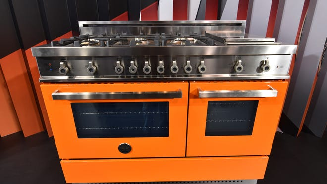 "This January 2016 photo shows a Bertazzoni oven in its ""Arancio"" color option, which is sure to be the focal point of any kitchen, at the Kitchen & Bath Industry Show in Las Vegas."