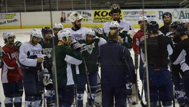 Ice Flyers coach Rod Aldoff meets with his team following Wednesday morning's practice at the Bay Center.