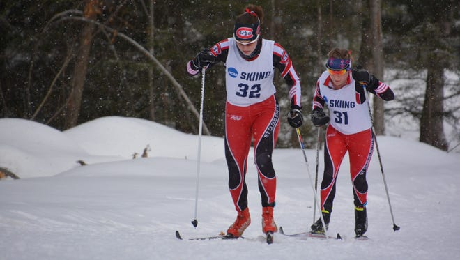 Haley Bock, left, and Berit Ramstad Skoyles of the St. Cloud State University Nordic ski team compete in the NCAA Central Region Skiing Championships, which were Feb. 20-21 in Marquette, Michigan. Second-year student Maria Hauer is helping organize a ski club for the women after the university announced it will cut its Nordic program, along with five others.