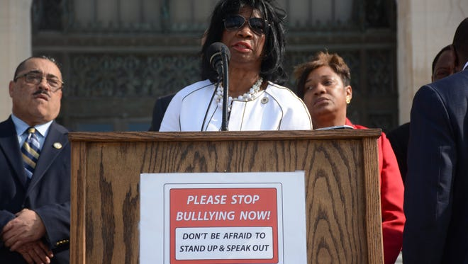 Rep. Barbara Norton, D-Shreveport, addresses two members of the press corps and a handful of legislative staff on the Statehouse steps Tuesday about her anti-bullying task force bill. She is flanked by Rep. Kenny Cox, D-Natchitoches, and Denise Marcelle, D-Baton Rouge.