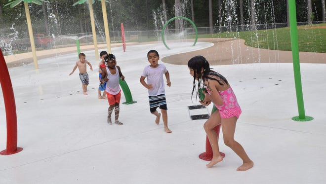 Viviana Martin (from right), Anderson Martin, Ka'Saria Butler, Jayden Dupree and Jacob Clark have fun at the new splash pad at Kees Park in Pineville. They were trying out the splash pad in anticipation of its official opening at 9 a.m. Friday, May 20. They gave it wet thumbs up.