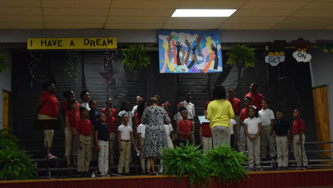The Acadian Spring 2016 Vocalists perform a concert Wednesday at Acadian Elementary School. The school doesn't have an official performing arts program. Students have used their physical education time to practice for concert.