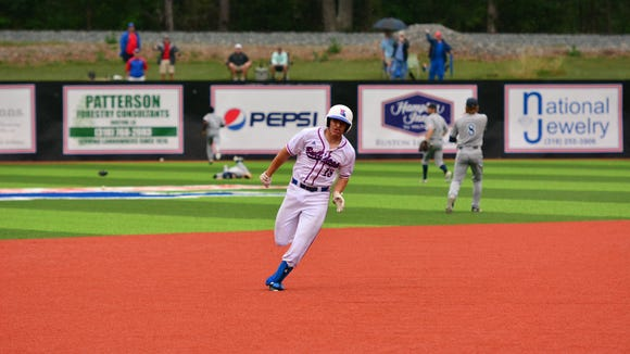 Louisiana Tech catcher Brent Diaz sprints around the