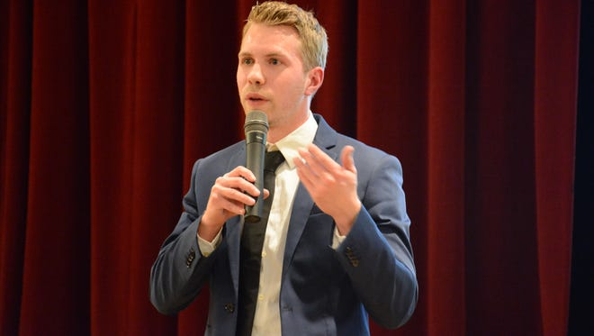 Whitney Point Mayor Ryan Reynolds speaks in May at a Whitney Point Community Action Awareness and Community Solutions event at the high school.