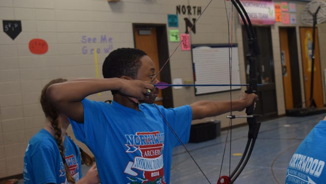 Northwood High School eighth-grader Tommy Aaron, 12, is in his second year of archery. He likes shooting at 3-D targets, which are like real animals, rather than bull's-eyes. He and 12 classmates are going to a world competition in June. He prepares to shoot during practice Tuesday.