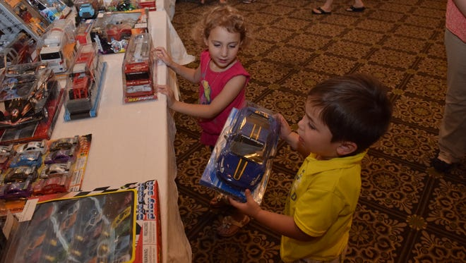 Estella Montalvo (left), 4, and her friend, Cale Givens, 3, pick out toys they like for the Alexandria Rotary Club and The Town Talk's Doll & Toy Fund. Rotarians and children met Wednesday with Don Opitz of Don Opitz Trading Company to pick out the best toys to give to Cenla kids this Christmas.